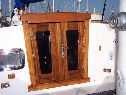 Teak companionway doors with six hinge design and door lock.