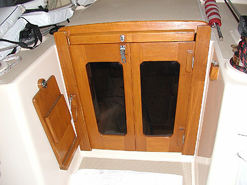 Companionway doors with matching teak components.
