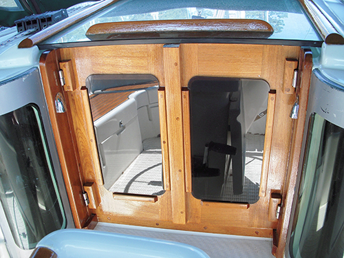 These companionway doors are perfectly flush with the hatch window.