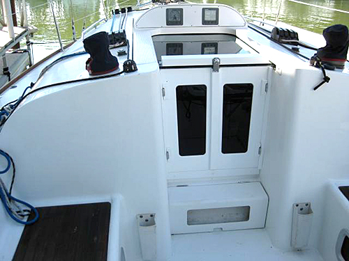 Starboard plastic companionway doors for a Beneteau sailboat.