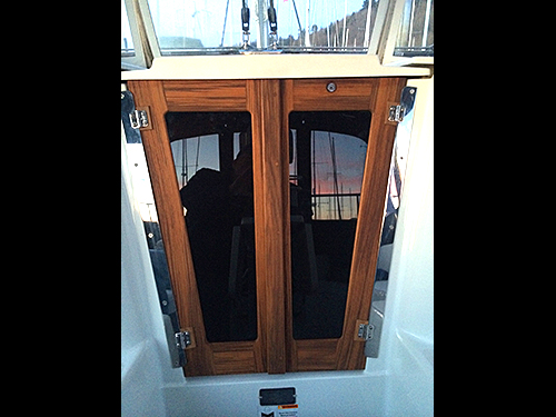 Catalina companionway doors made with solid teak.