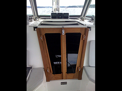 Cruising Concepts' stainless steel hinges blend with the companionway doors and fascia.