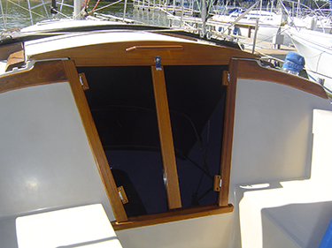 Companionway doors with teak wood frames and acrylic window panes.
