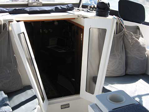 Cruising Concepts starboard companionway doors latched open.