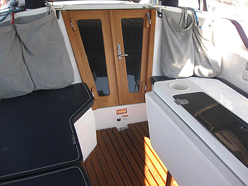 Teak companionway doors with stainless steel door handle.