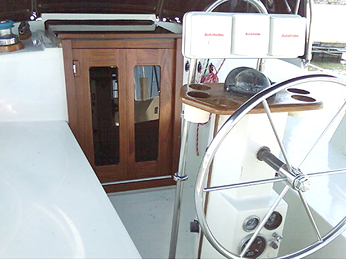 These teak companionway doors were specifically cut for this square mounting.