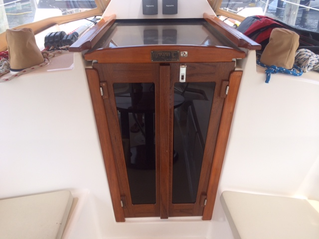 Sailboat companionway doors with matching teak hatchframe.