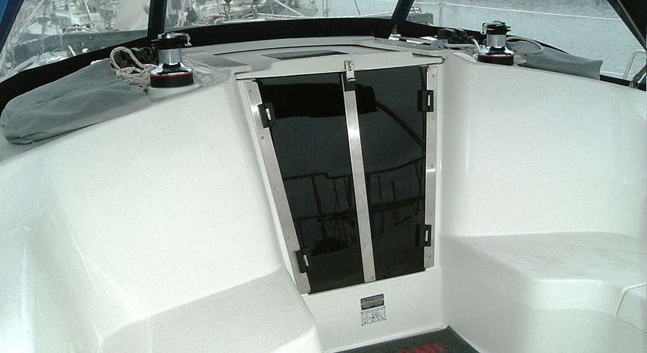 Acrylic companionway doors with stainless steel frame and trim.