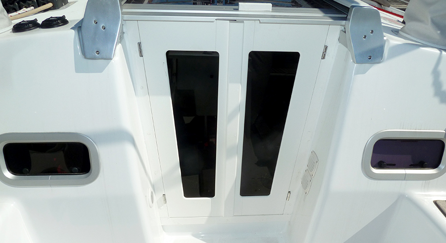 Full sized starboard plastic companionway doors cut to match the fascia.